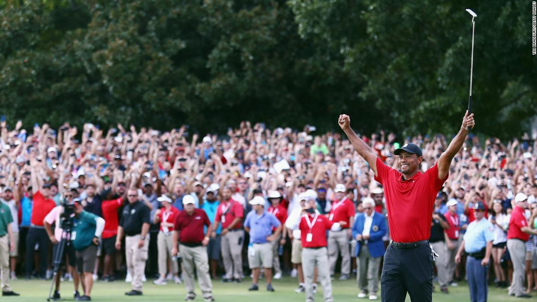 "Tiger Woods celebrates after <a href=""https://www.cnn.com/2018/09/23/golf/tiger-woods-tour-championship-spt-intl/index.html"">winning the PGA Tour Championship</a> at East Lake Golf Club in Atlanta on Sunday, September 23."