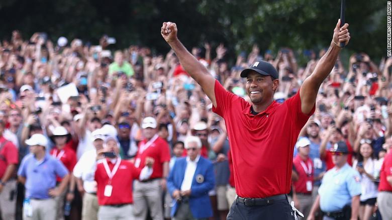 "Tiger Woods celebrates after <a href=""https://www.cnn.com/2018/09/23/golf/tiger-woods-tour-championship-spt-intl/index.html"">winning the PGA Tour Championship</a> at East Lake Golf Club in Atlanta on Sunday, September 23."