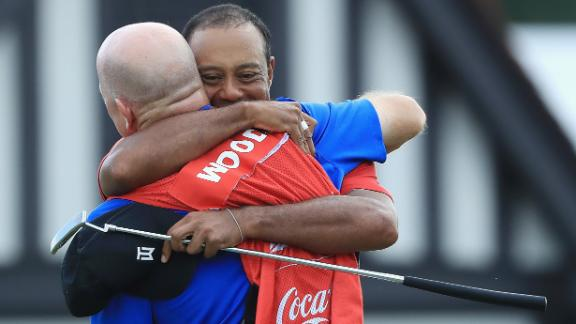 Woods hugs caddie Joe LaCava after winning. Woods has been plagued by pain and injury problems in recent years.