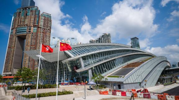 The flags of Hong Kong (L) and China are seen hoisted outside the West Kowloon train station of the High Speed Rail Link to Guangzhou as sales counters were opened to the public for the first time in Hong Kong on September 10, 2018.