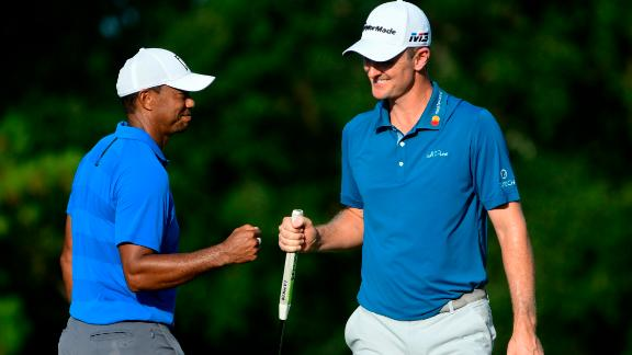 Woods and Justin Rose fist-bump on the 16th green during the third round Saturday, September 22.