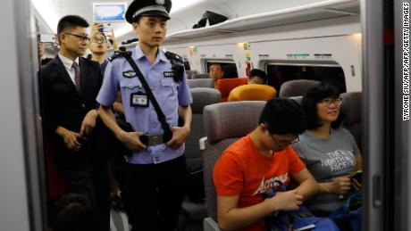 A Chinese police officer patrols a train on the first day of service of the Guangzhou-Shenzhen-Hong Kong Express Rail Link in Hong Kong on September 23, 2018.