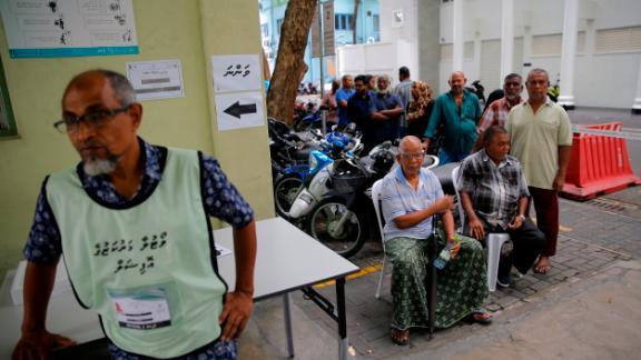 Maldivians queue to vote in the capital Male.