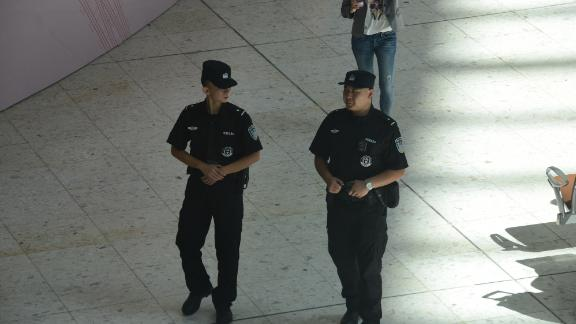 Chinese police patrol part of the West Kowloon Station in Hong Kong which is under Chinese law.