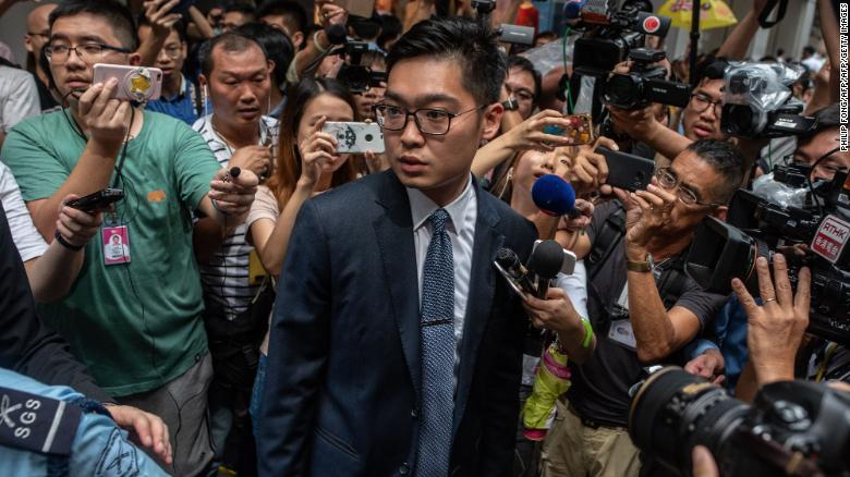 Andy Chan (C), founder of the Hong Kong National Party, is surrounded by members of the media as he leaves the Foreign Correspondents' Club (FCC) in Hong Kong on August 14, 2018.