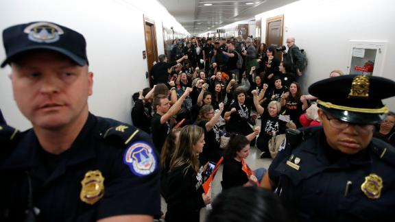 Capitol Hill Police move the crowd back as protesters speak out against Judge Brett Kavanaugh outside the office of Sen. Susan Collins, R-Maine, on Capitol Hill, Monday, Sept. 24, 2018 in Washington. A second allegation of sexual misconduct has emerged against Judge Brett Kavanaugh, a development that has further imperiled his nomination to the Supreme Court, forced the White House and Senate Republicans onto the defensive and fueled calls from Democrats to postpone further action on his confirmation. President Donald Trump is so far standing by his nominee. (AP Photo/Alex Brandon)