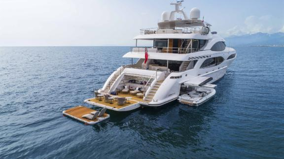 """Designed for long range cruising, the Mangusta 46 features a large fold-down swim platform which is """"ideal for relaxing or launching water toys."""""""