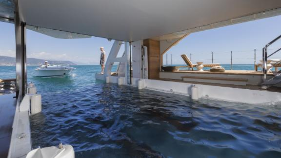 Seven Sin features a float-in tender garage which also transforms into a beach club -- which has fold-down side balconies and is fully equipped with a gym and sauna.