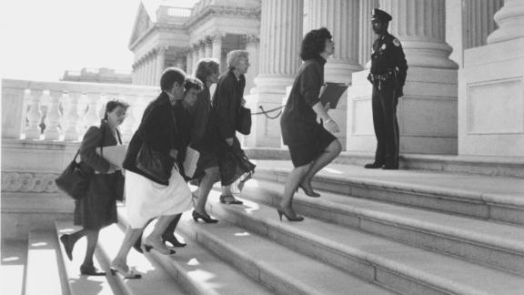 Published October 9, 1991 Published Caption:  Barbara Boxer leading Congresswomen to the Senate side of the Capitol yesterday to seek a delay in vote on the Thomas Nomination. (Paul Hosefros/The New York Times) Description:  Seven congresswomen, led by Barbara Boxer marched to the U.S. Senate on October 8, 1991 demanding a delay in the vote confirming Clarence Thomas to the Supreme Court until lthe charges of sexual harassment brought against Thomas by Prof. Anita Hill were investigated.