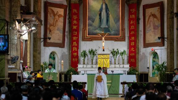 Christian devotees attend a mass at the South Cathedral in Beijing on September 22.