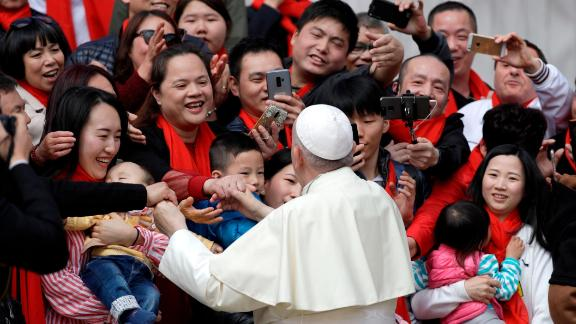 Pope Francis meets a group of faithful from China at the end of his weekly general audience in St. Peter's Square, at the Vatican on April 18.