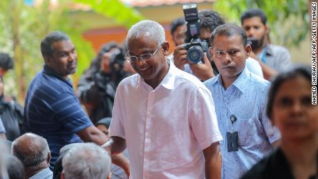 Opposition Maldives candidate for president Ibrahim Mohamed Solih arrives at a polling station to vote in the capital Male on September 23, 2018.