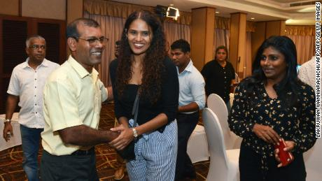 Former president of the Maldives Mohamed Nasheed is congratulated by Solih's supporters  at a hotel in Colombo.