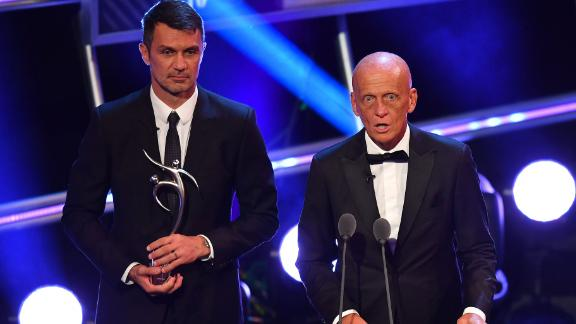 Former Italian referee Pierluigi Collina (R) and former Italy and AC Milan defender Paolo Maldini presented an award on the evening for fair play, which went to German player  Lennart Thy.