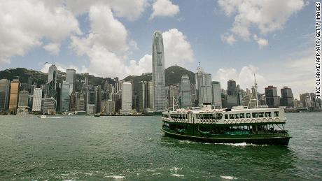 HONG KONG, CHINA:  A Star Ferry makes its way across Hong Kong's Victoria Harbour on the way to the Kowloon district of Hong Kong, 28 June 2005.  There have only been a handful of days this year with clear visibility all the way to The Peak (at rear)      AFP PHOTO/MIKE CLARKE  (Photo credit should read MIKE CLARKE/AFP/Getty Images)