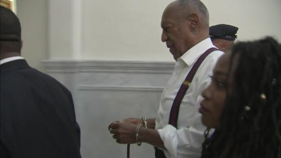 Bill Cosby is taken out of the courtroom in handcuffs after his sentencing Tuesday.