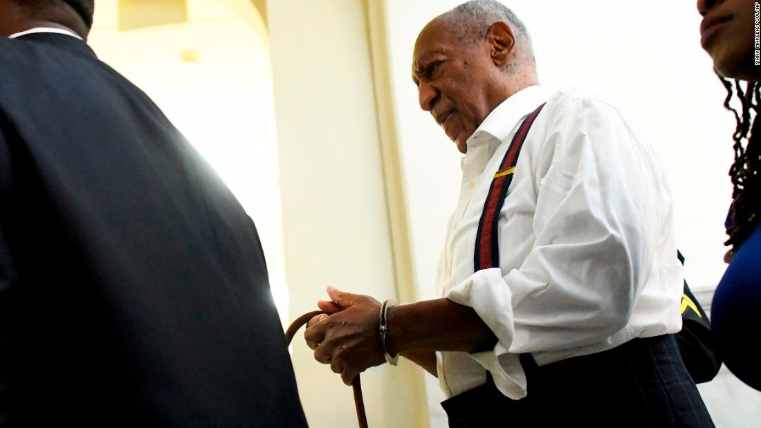 "Bill Cosby is taken away in handcuffs after he <a href=""https://www.cnn.com/2018/09/25/us/bill-cosby-sentence-assault/index.html"" target=""_blank"">received a prison sentence of three to 10 years</a> on Tuesday, September 25. In April, the entertainer had been found guilty of drugging and sexually assaulting Andrea Constand 14 years ago."