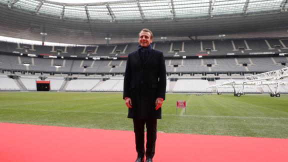 France's president Emmanuel Macron, posing here during a visit to the Stade de France, threw his support behind the 2024 bid.