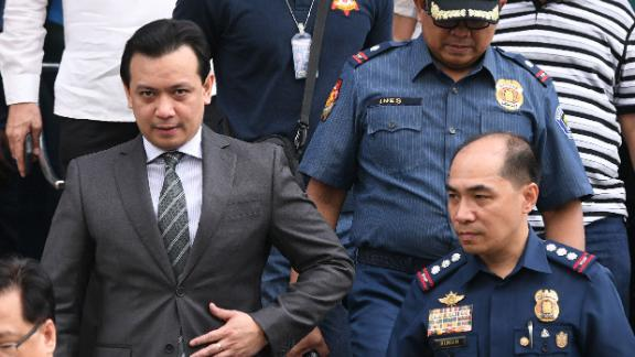 Philippines senator Antonio Trillanes (L) leaves a police station after being arrested in Manila on September 25, 2018.