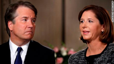 Brett Kavanaugh, left, looks at his wife Ashley Estes Kavanaugh as they answer questions during a Fox News interview.