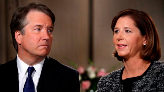 Brett Kavanaugh, left, looks at his wife Ashley Estes Kavanaugh as they answer questions during a FOX News interview, Monday, Sept. 24, 2018, in Washington, about allegations of sexual misconduct against the Supreme Court nominee. (AP Photo/Jacquelyn Martin)