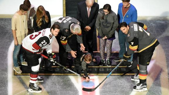 The ceremonial first puck is dropped between Oliver Ekman-Larsson of the Arizona Coyotes and Jason Garrison of the Golden Knights before the Golden Knights