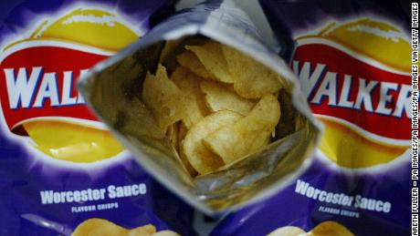 Environmental activists are returning their Walkers potato chip bags through the mail as part of a campaign to push the snack giant to make its packaging plastic-free.
