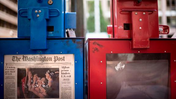 A Washington Post newspaper box (L) stands beside the empty box of competitor Washington Times (R) outside the Washington Post on August 5, 2013 in Washington, DC, after it was announced that Amazon.com founder and CEO Jeff Bezos had agreed to purchase the Post for USD 250 million.  Multi-billionaire Bezos, who created Amazon, which has soared in a few years to a dominant position in online retailing, said he was buying the Post in his personal capacity and hoped to shepherd it through the evolution away from traditional newsprint.   AFP PHOTO/Brendan SMIALOWSKI        (Photo credit should read BRENDAN SMIALOWSKI/AFP/Getty Images)