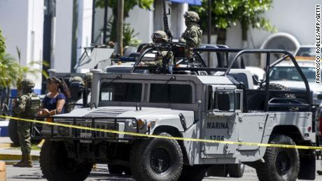 Members of the Mexican navy and federal police take part in an operation Tuesday in Acapulco.
