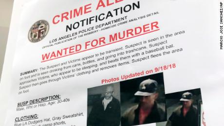 An LAPD wanted poster with surveillance photos of a person they were seeking over the series of attacks.