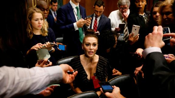 Actress Alyssa Milano talks to media before the Senate Judiciary Committee hearing on the nomination of Brett Kavanaugh to be an associate justice of the Supreme Court of the US in Washington, DC, on September 27, 2018. - Washington was bracing Thursday for a charged hearing pitting Donald Trump's Supreme Court pick Brett Kavanaugh against his accuser Christine Blasey Ford, who is set to detail sexual assault allegations against the judge that could derail his already turbulent confirmation process. (Photo by MICHAEL REYNOLDS / POOL / AFP)        (Photo credit should read MICHAEL REYNOLDS/AFP/Getty Images)
