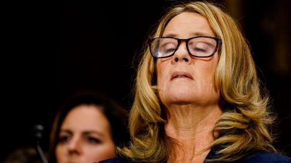 WASHINGTON, DC - SEPTEMBER 27: Christine Blasey Ford takes a breath at a Senate Judiciary Committee hearing in the Dirksen Senate Office Building on Capitol Hill September 27, 2018 in Washington, DC. A professor at Palo Alto University and a research psychologist at the Stanford University School of Medicine, Ford has accused Supreme Court nominee Judge Brett Kavanaugh of sexually assaulting her during a party in 1982 when they were high school students in suburban Maryland.  (Photo by Melina Mara/Pool/Getty Images)
