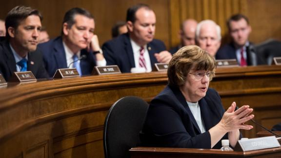 UNITED STATES - SEPTEMBER 27: Rachel Mitchell, counsel for Senate Judiciary Committee Republicans, questions Dr. Christine Blasey Ford as Senators, from left, Ben Sasse, R-Neb., Ted Cruz, R-Texas, Mike Lee, R-Utah.,  and John Cornyn, R-Texas, listen during the Senate Judiciary Committee hearing on the nomination of Brett M. Kavanaugh to be an associate justice of the Supreme Court of the United States, focusing on allegations of sexual assault by Kavanaugh against Christine Blasey Ford in the early 1980s. (Photo By Tom Williams/CQ Roll Call/POOL)