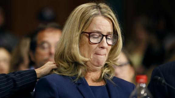 Christine Blasey Ford reacts as she speaks before the Senate Judiciary Committee hearing on the nomination of Brett Kavanaugh to be an associate justice of the Supreme Court of the United States, on Capitol Hill in Washington, DC, U.S., September 27, 2018. Michael Reynolds/Pool via REUTERS