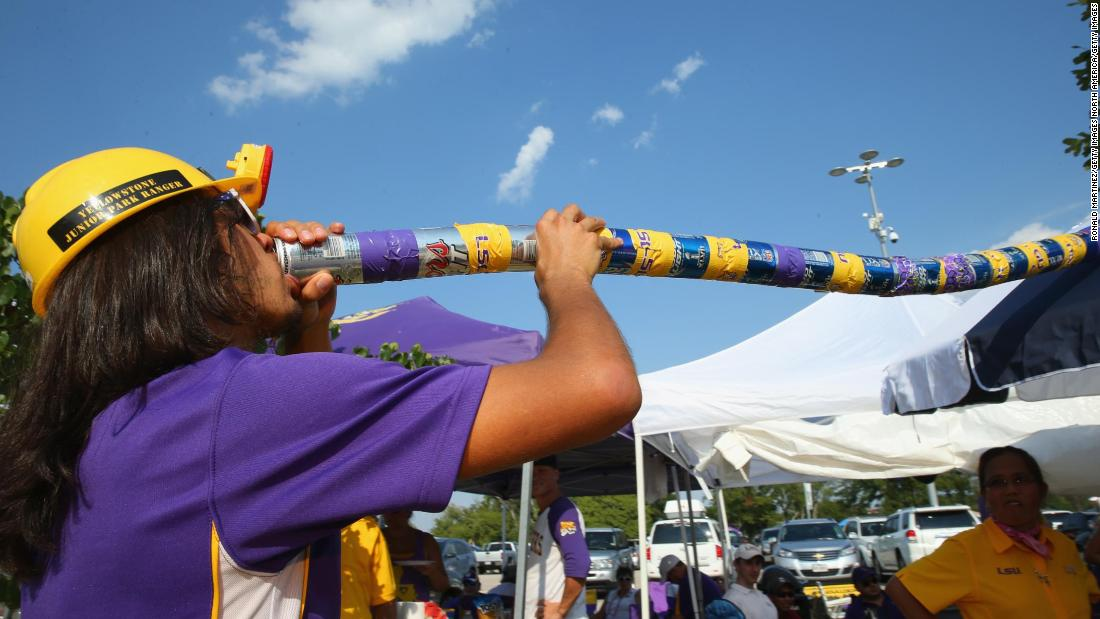 An LSU Tigers fan drinks a beer through a funnel before a game against the TCU Horned Frogs at AT&T Stadium on August 31, 2013 in Arlington, Texas.
