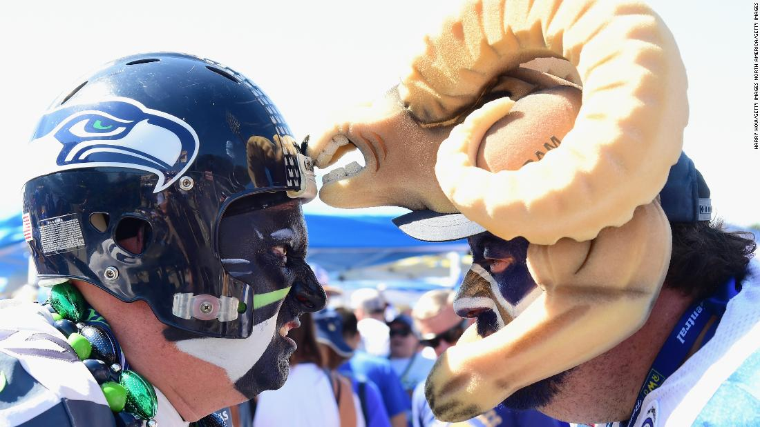 "Seattle Seahawks fan Brad Carter, aka ""Cannonball"" (L) faces off with Karl Sides, aka ""The Ram Man"" (R) before the start of the Los Angeles Rams home opening NFL game at the Los Angeles Memorial Coliseum on September 18, 2016."