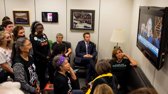 In this September 27, 2018, file photo, Protesters and supporters of Supreme Court Nominee Brett Kavanaugh watch Christine Blasey Ford