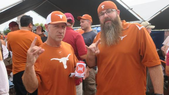 "Texas Longhorns fan Steve Lawrence (left) has been tailgating for 11 years, but prefers to remain in the parking lot rather than attend the games. ""I get tickets all the time, and I get rid of them,"" he said, before the Texas - USC game on September 15."
