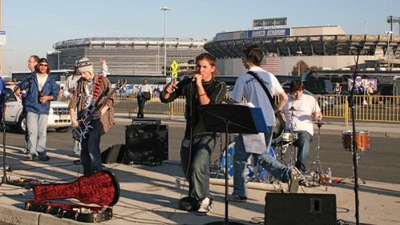 Uberoi's son brought his band to a tailgate, while the team was still preparing MetLife Stadium (left, background).