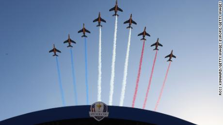 The Patrouille de France flies over during the opening ceremony at Le Golf National.