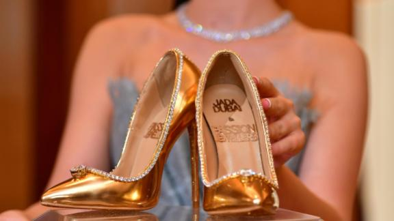 A pair of shoes worth 17 million US dollars are seen on display at Burj Al Arab during the launch presentation in Dubai on September 26, 2018. - The Passion Diamond Shoes, features hundreds of diamonds, together with two imposing D-flawless diamonds of 15 carats each. (Photo by GIUSEPPE CACACE / AFP)        (Photo credit should read GIUSEPPE CACACE/AFP/Getty Images)