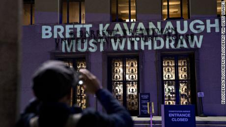 "The words ""Brett Kavanaugh Must Withdraw"" are projected by demonstrators onto the E. Barrett Prettyman United States Courthouse in Washington, D.C., U.S., on Tuesday, Sept. 25, 2018."