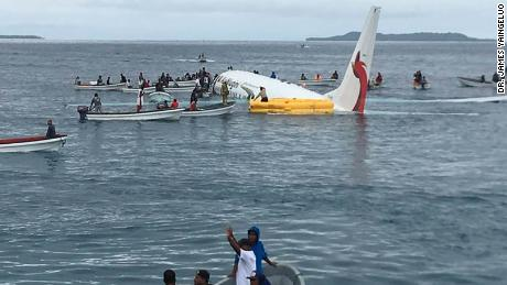 Plane lands short on runway, crashes into sea. '