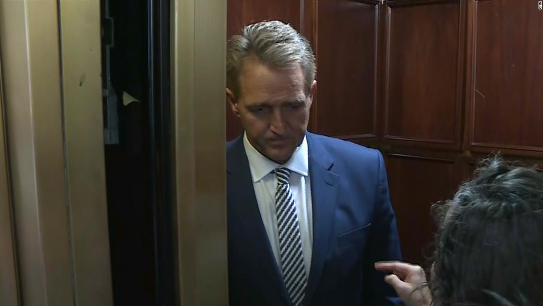 Flake confronted by two female protesters