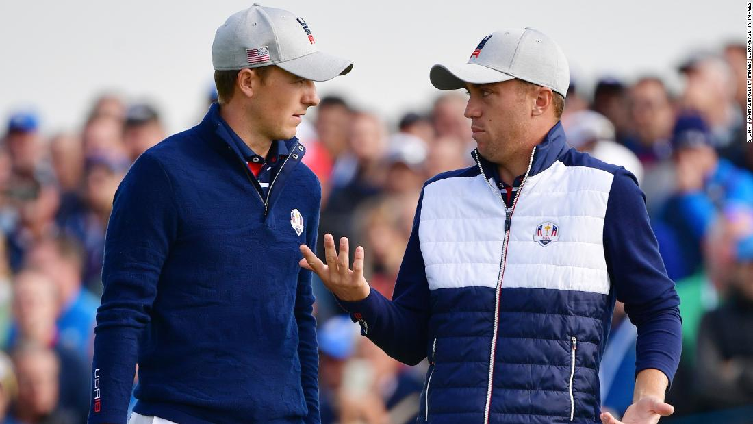 Thomas and Spieth of the United States talk during the Friday morning four-ball matches.