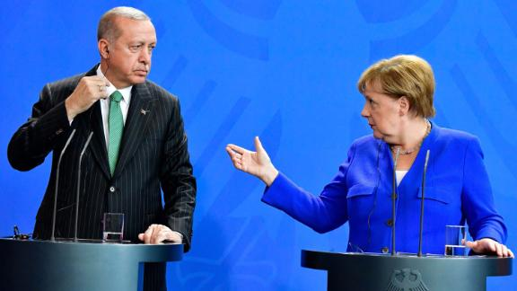 Turkish President Recep Tayyip Erdogan and German Chancellor Angela Merkel hold a joint news conference in Berlin Friday.