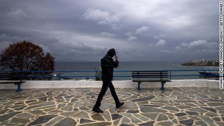 A man walks alongside the Rafina Port during heavy storm in Athens, Greece on September 28.