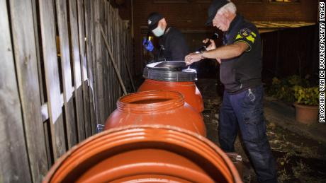 Dutch police officers conduct an investigation at the residence of an alleged jihadist in Arnhem, the Netherlands, on Thursday.