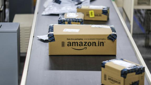 Packages move along a conveyor belt at the Amazon.com Inc. fulfillment center in Hyderabad, India.