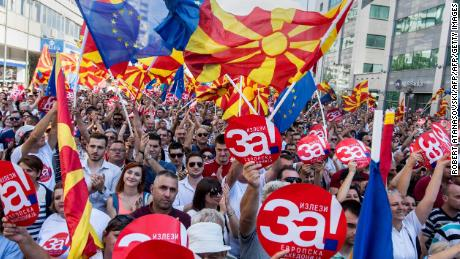 People wave then-Macedonian and European flags during a rally in September ahead of the name change referendum.